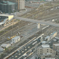 ミッドランドスクエア「スカイプロムナード」から見た景色(夕方) - 24:ささしまライブ駅と、ささしま米野歩道橋