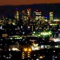 アピタ高蔵寺店屋上から見た景色(夕暮れ時) - 27:王子製紙の煙突越しに見えた名駅ビル群